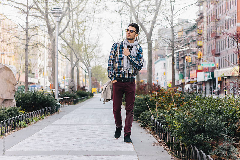 Hip Urban Young Man Walking in New York by Joselito Briones for Stocksy United
