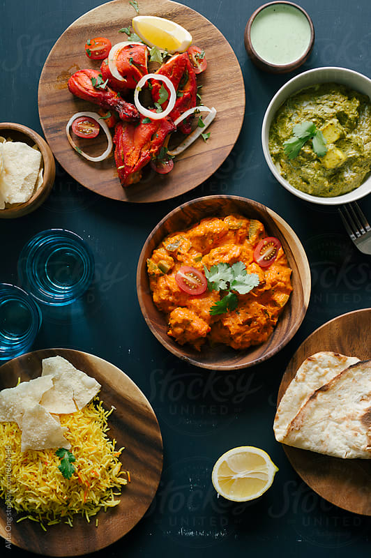 Assorted Indian dishes from above by Alita Ong for Stocksy United