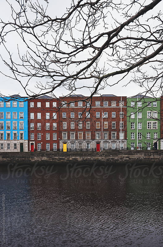Colored buildings in Dublin along the Liffey river by Luca Pierro for Stocksy United