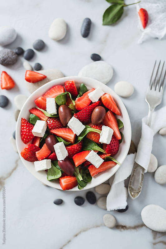 Corn salad with strawberries by Tatjana Ristanic for Stocksy United