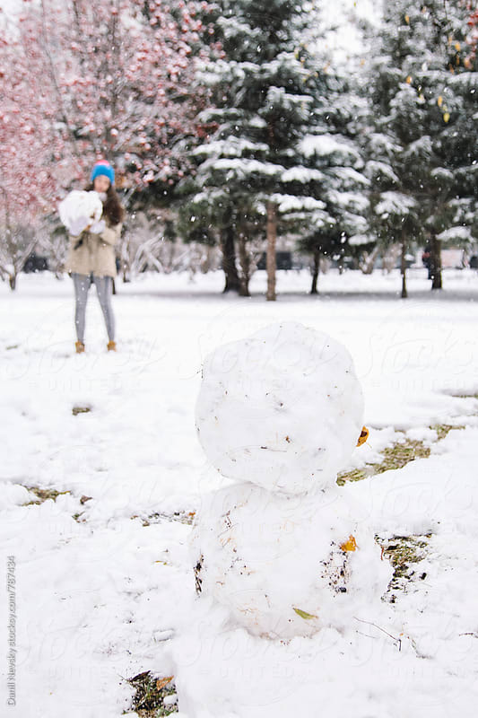 Photo of two snowballs in park by Danil Nevsky for Stocksy United