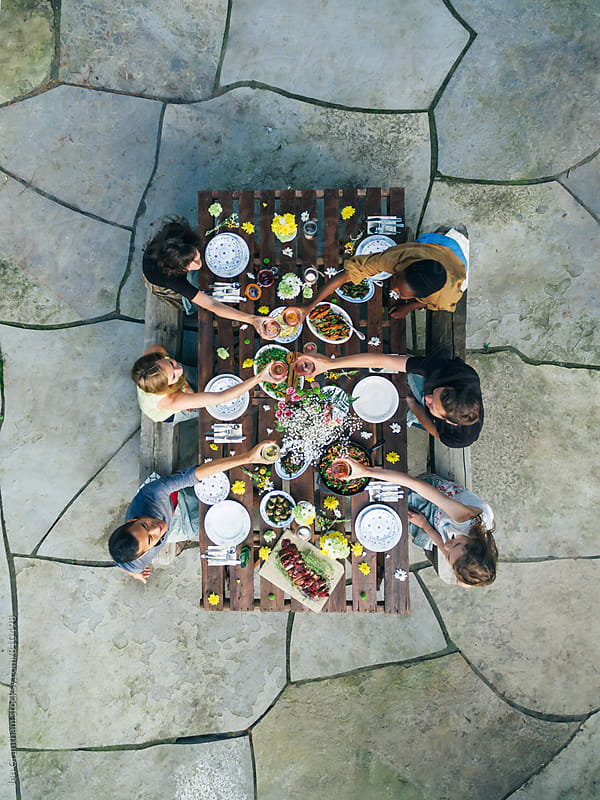 Outdoor summer dinner party by Jen Grantham for Stocksy United