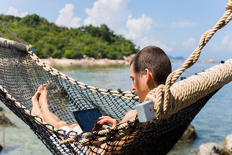 Man With Tablet Computer in the Hammock by Mosuno for Stocksy United