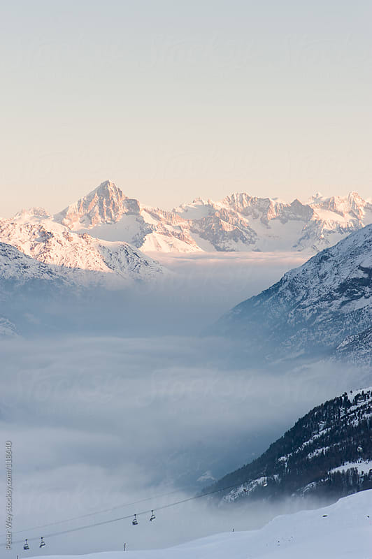 Bietschorn mountain peak above cloudscape by Peter Wey for Stocksy United