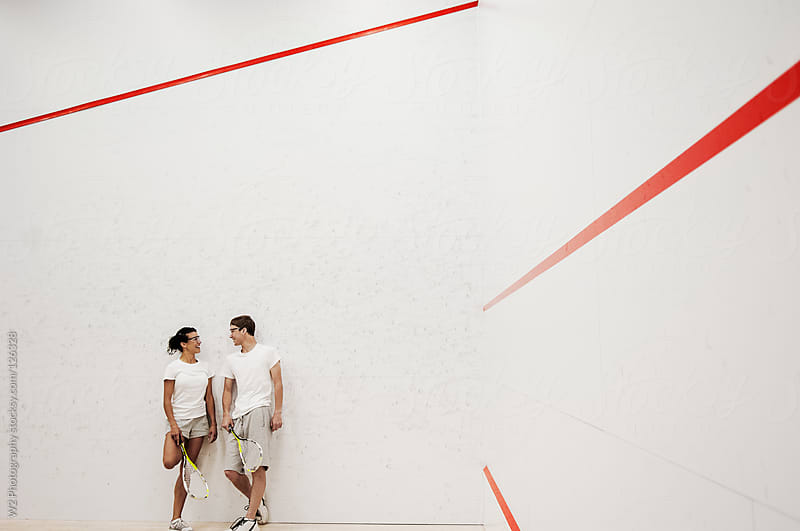Couple at a squash court by W2 Photography for Stocksy United