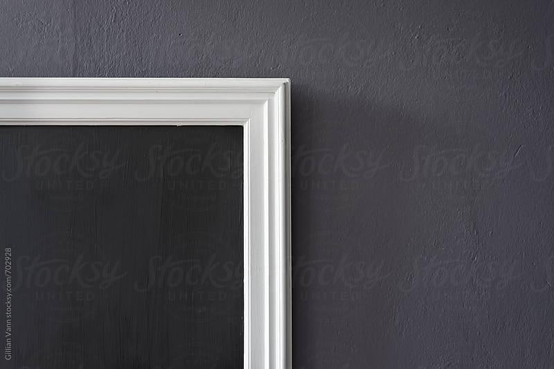 blank blackboard on a wall by Gillian Vann for Stocksy United