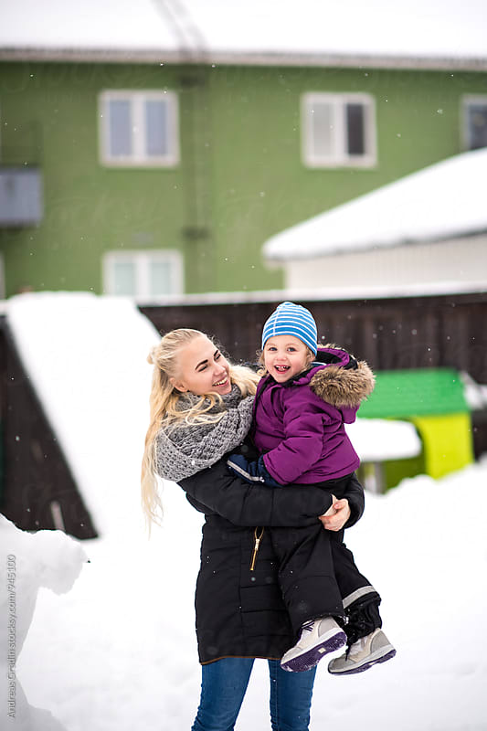 family fun in the snow by Andreas Gradin for Stocksy United