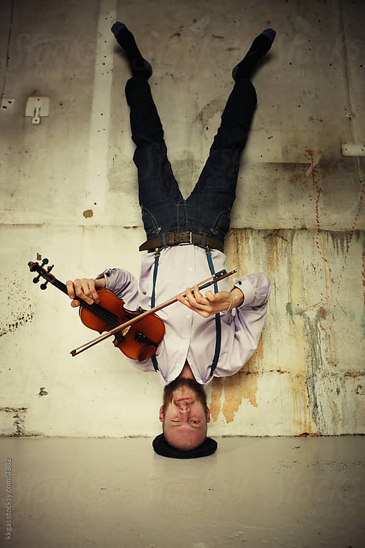 Man playing the violin upside down.  by kkgas for Stocksy United