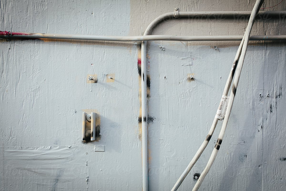 Electrical Wires On Building Wall | Stocksy United