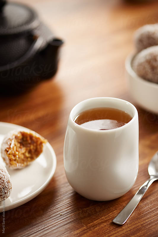 Tea cup with paleo snacks by Martí Sans for Stocksy United