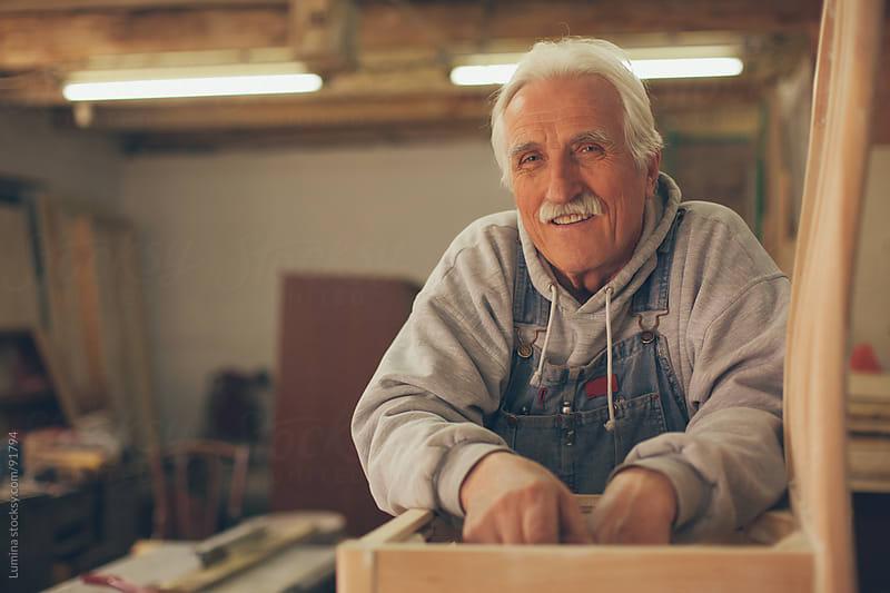 Elderly Carpenter at His Workshop by Lumina for Stocksy United