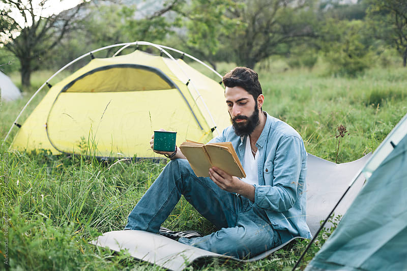 Young bearded man camping by Aleksandar Novoselski for Stocksy United