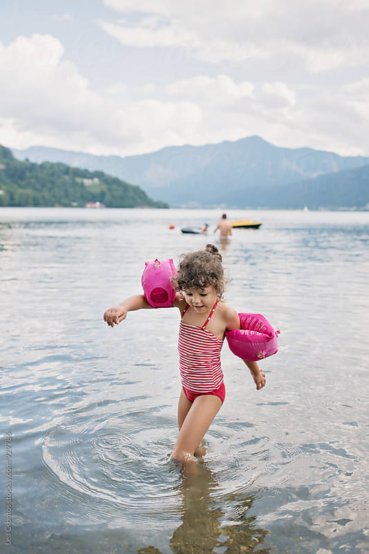 Little girl having fun in a lake by Lea Csontos for Stocksy United