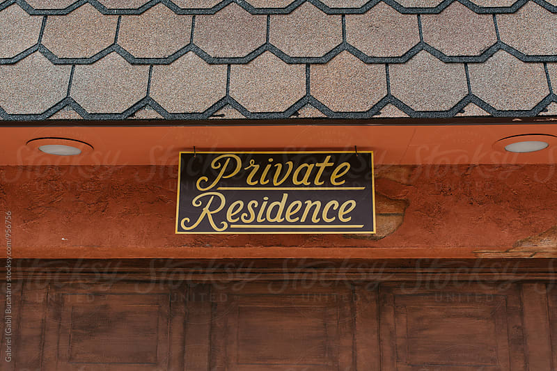 Private residence sign above a door by Gabriel (Gabi) Bucataru for Stocksy United