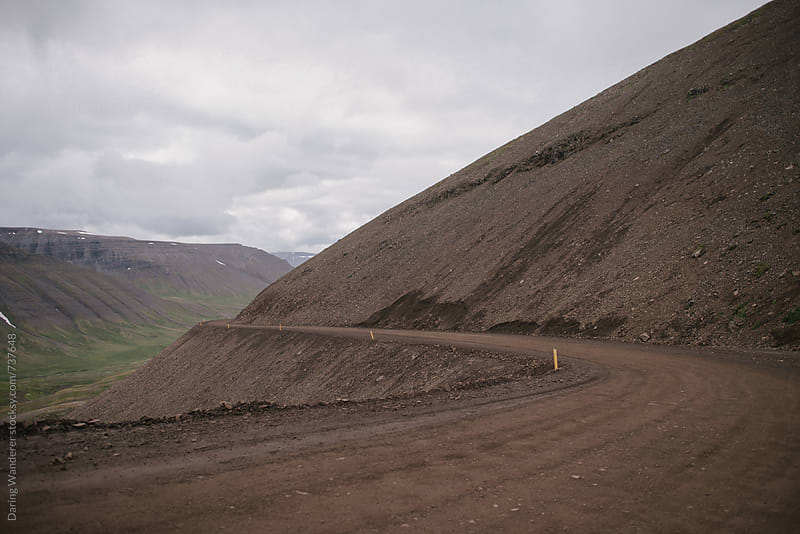 Remote gravel mountain road in the west fjords in Iceland by Daring Wanderer for Stocksy United