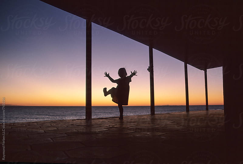 Girl Playing on Porch Cape Cod, Massachusetts by Raymond Forbes LLC for Stocksy United