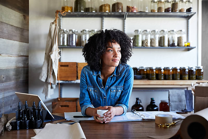 Millennial African American Woman businesswoman in her skincare studio by Trinette Reed for Stocksy United