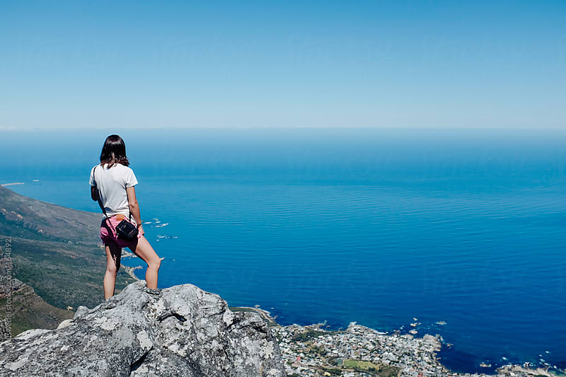 Woman taking in the view from the top of Table Mountain by Micky Wiswedel for Stocksy United