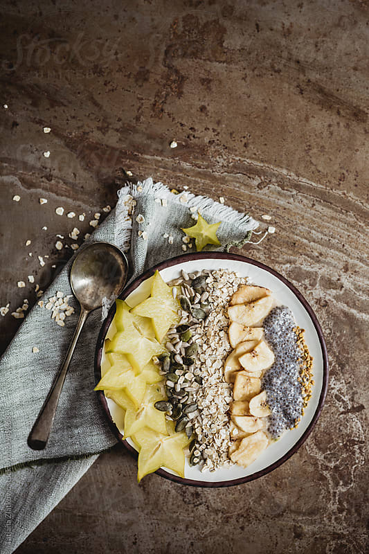 Muesli with carambola, seeds, dried banana and pollen by Tatjana Ristanic for Stocksy United
