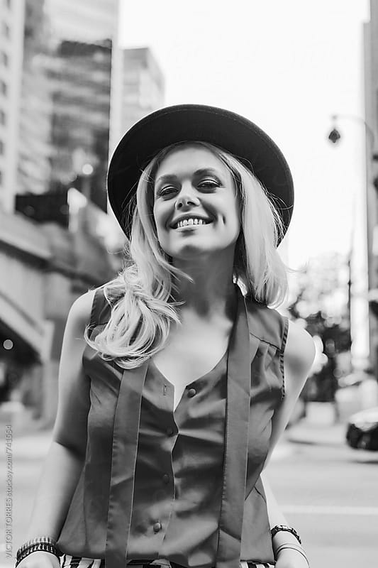 Young Happy Blond Woman in the Street by Victor Torres for Stocksy United