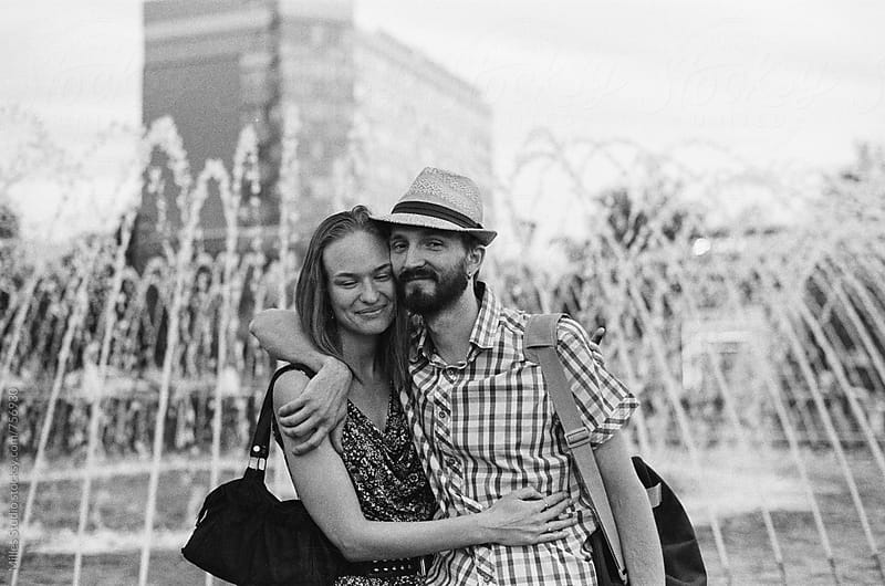 Couple hugging near fountain by Milles Studio for Stocksy United