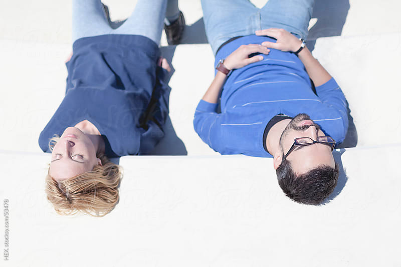 Couple Relax. Urban Sunbath by HEX. for Stocksy United
