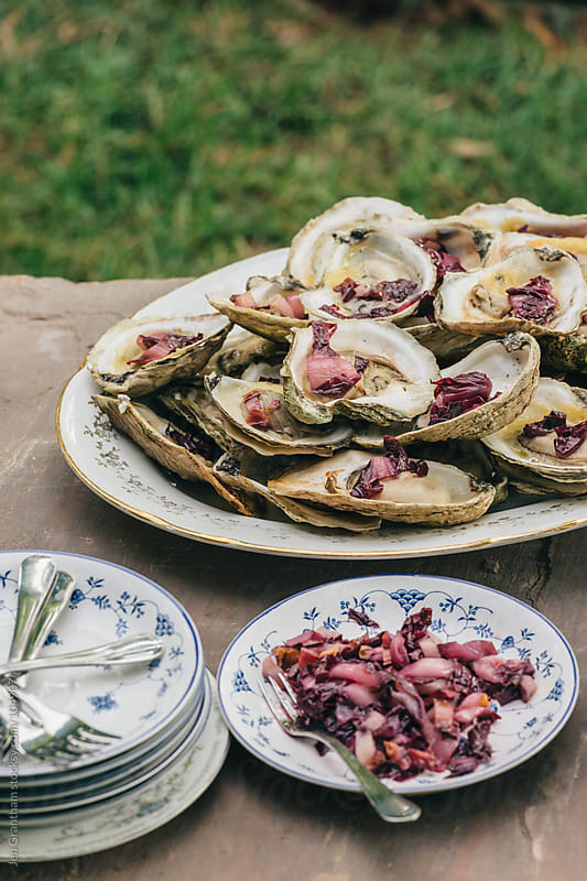 Cooked oysters with miso butter and pickled treviso by Jen Grantham for Stocksy United