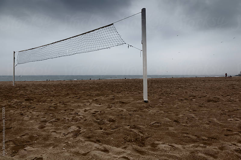 Old beach volley net on Trouville Beach in Normandy, France by Ivan Bastien for Stocksy United