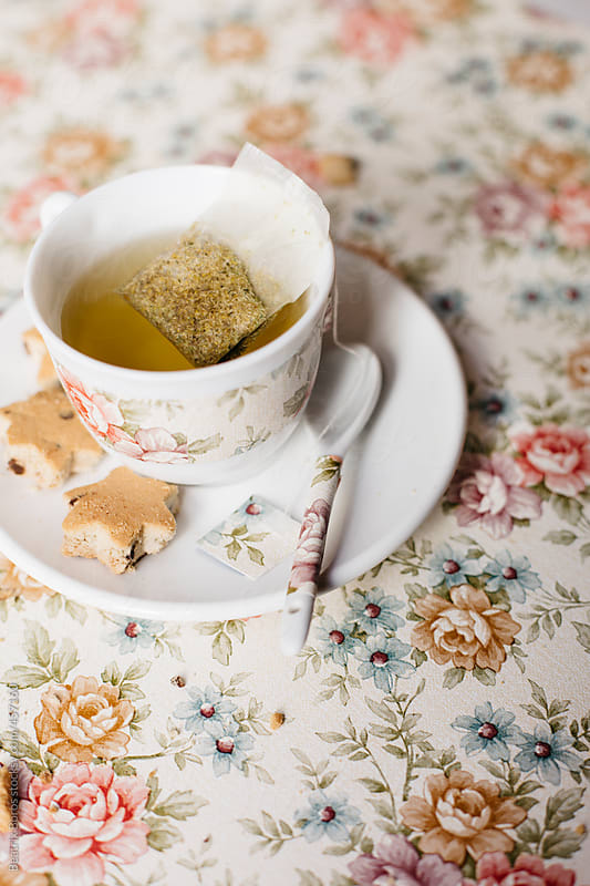 Trendy cup of tea with trendy teaspoon and biscuits by Beatrix Boros for Stocksy United