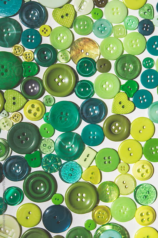 Green buttons... by Catherine MacBride for Stocksy United