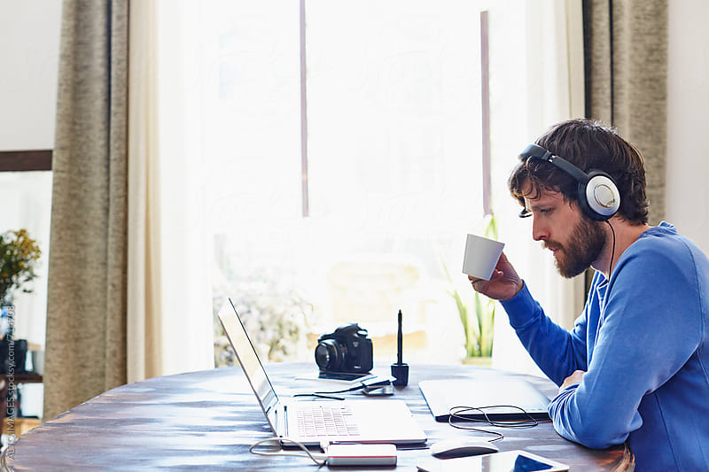 Man Having Coffee While Listening Music At Home by ALTO IMAGES for Stocksy United