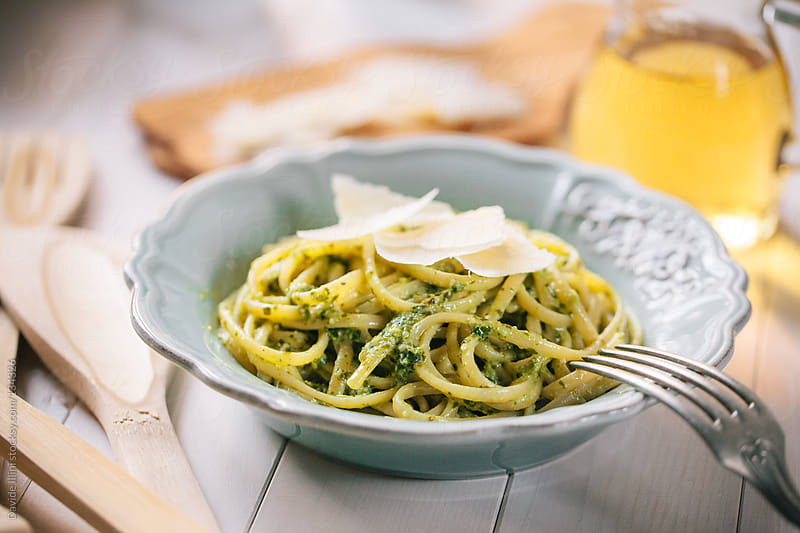 Spaghetti with pesto sauce by Davide Illini for Stocksy United