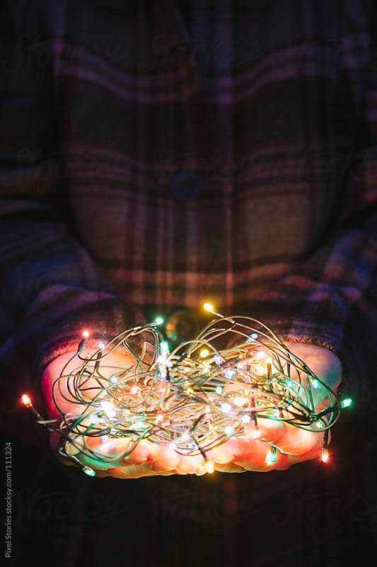 Holding Christmas lights by Pixel Stories for Stocksy United