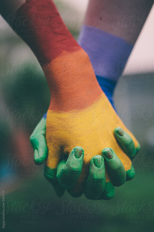 Hands painted in Gay pride rainbow. by kkgas for Stocksy United