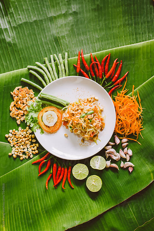 Som Tam or thai spicy papaya salad well decorated on banana leaves by Nabi Tang for Stocksy United
