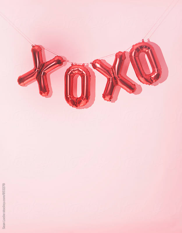 Valentine: Hugs And Kisses Balloon Banner Background by Sean Locke for Stocksy United
