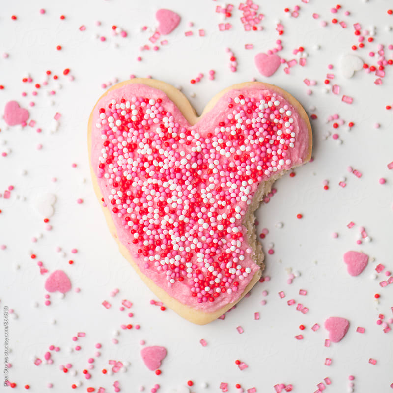 Heart-shaped cookie with a bite by Pixel Stories for Stocksy United