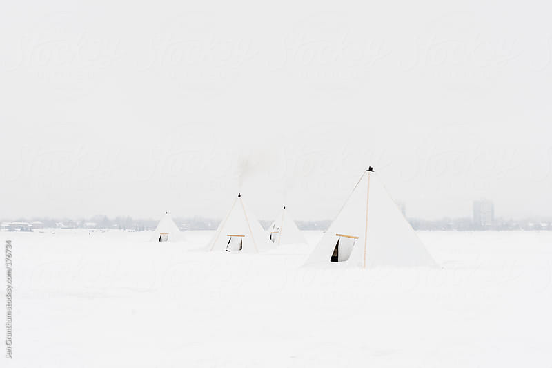 Ice fishing huts by Jen Grantham for Stocksy United