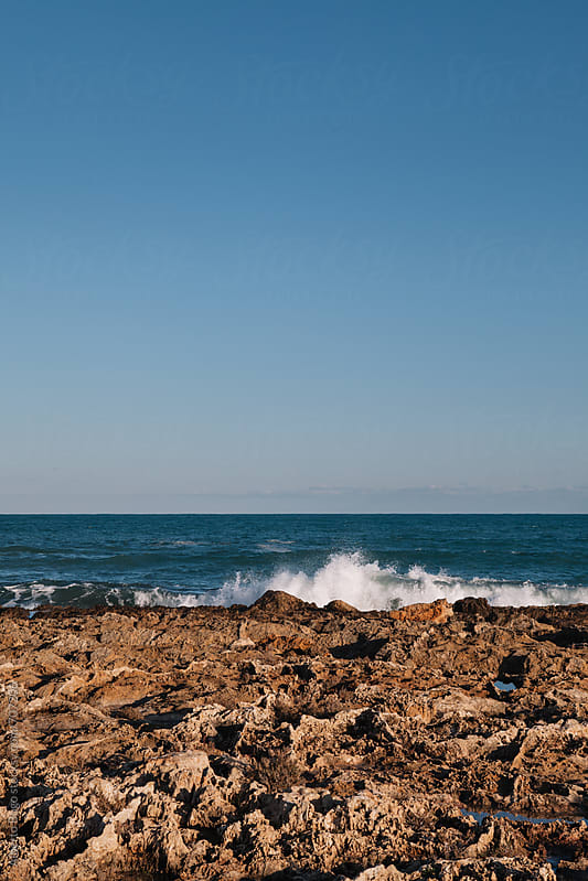 High wave smash the beach by Alberto Bogo for Stocksy United