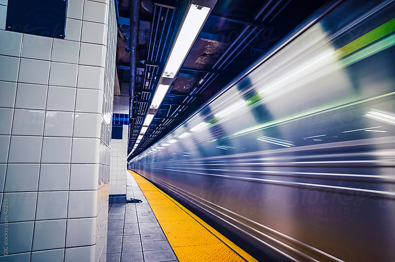 Fast subway train in New York City by Simone Becchetti for Stocksy United