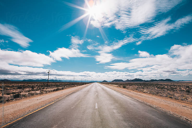 Empty straight road into the horizon by Micky Wiswedel for Stocksy United