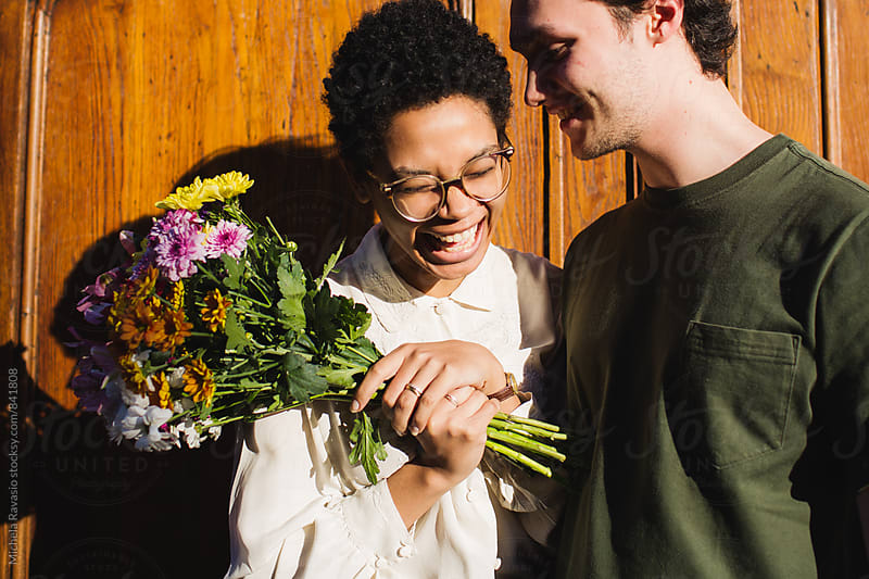 Smiling couple on a date outdoors by michela ravasio for Stocksy United
