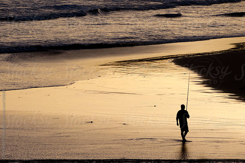 Walking Fisherman on an Australian Beach in Silhouette by Gary Radler Photography for Stocksy United