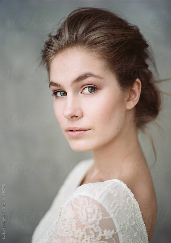 Portrait of young woman by Liubov Burakova for Stocksy United