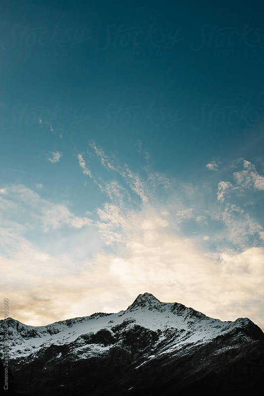 mountain and sky in New Zealand by Cameron Zegers for Stocksy United