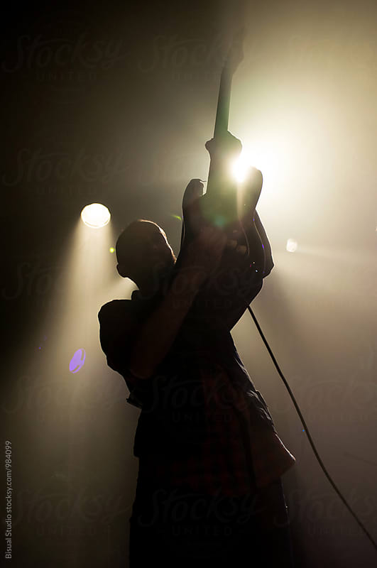 Silhouette of a Guitarist on a concert by Bisual Studio for Stocksy United