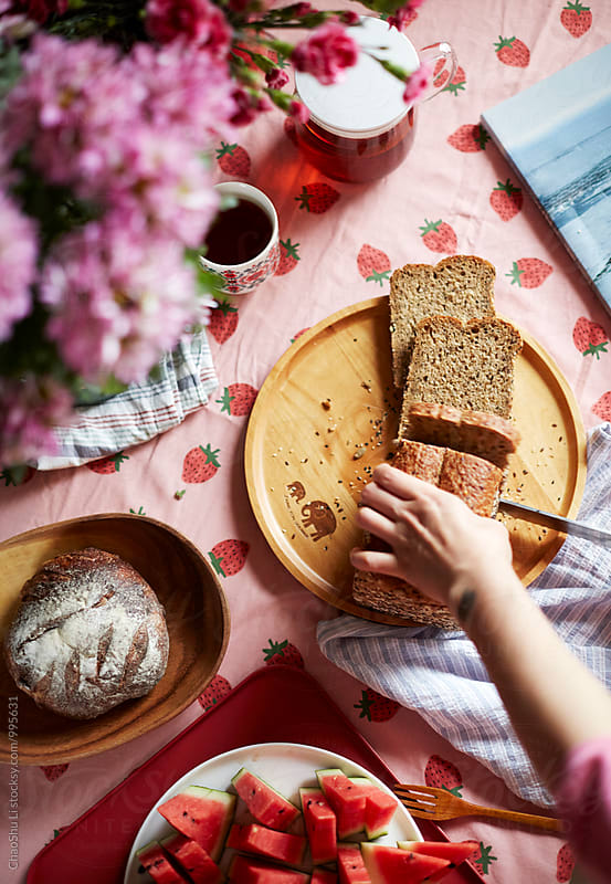 Delicious bread on the table,Hand-cut bread by ChaoShu Li for Stocksy United