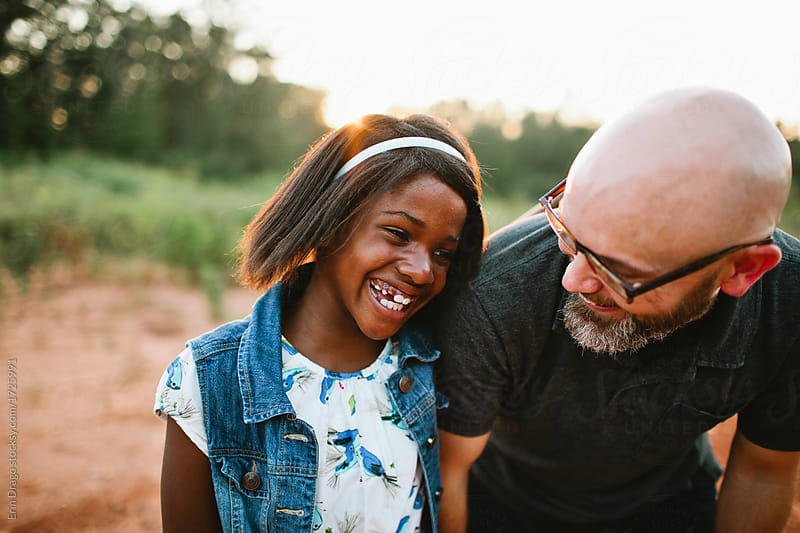 Father and Daughter of different races, laughing together