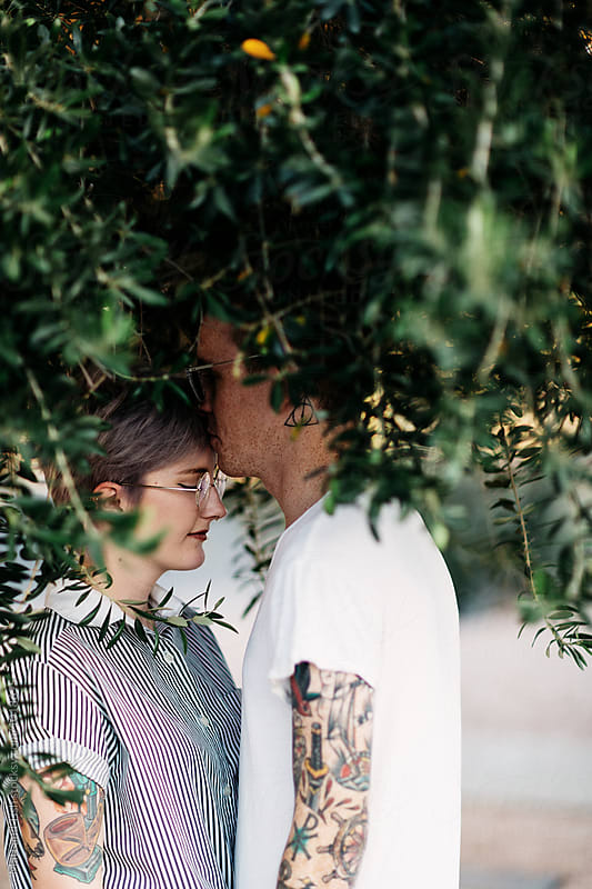 Couple under tree by Matt and Tish for Stocksy United