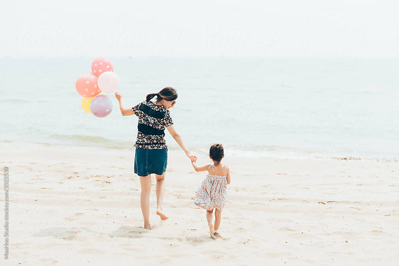 Cute toddler girl and her mother on the seaside by Maa Hoo for Stocksy United
